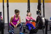 Little Girl Using Rowing Machine