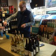 Man pouring wine samples